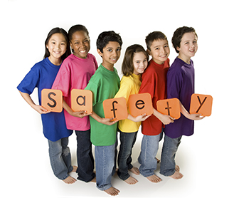 Kids with a safety sign