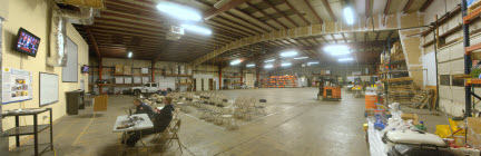 Picture of the NMRT Warehouse showing responders, supplies and equipment