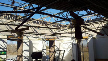 Damaged roof on the second floor of the hospital.