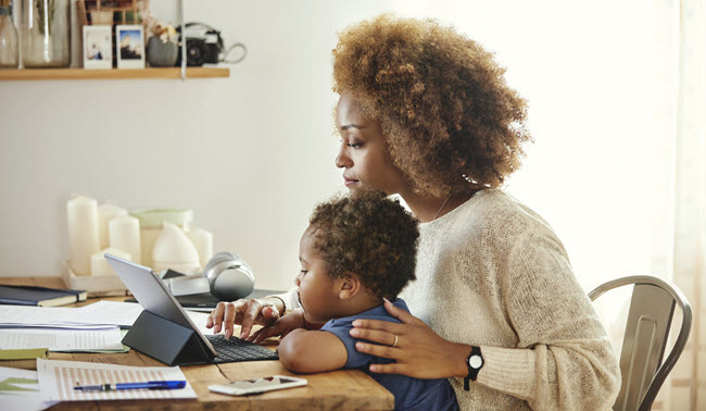 Woman teleworking with child